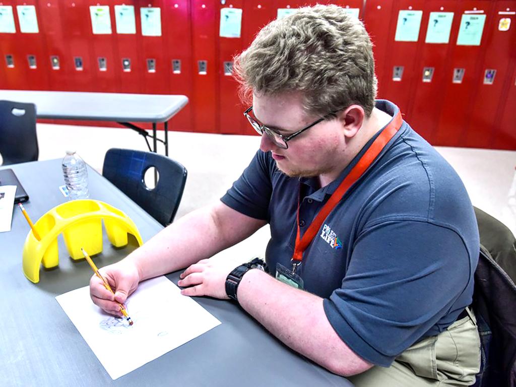 発達障害の生徒がそれぞれの子の困難を助けるためのまんがを描く b1-2
